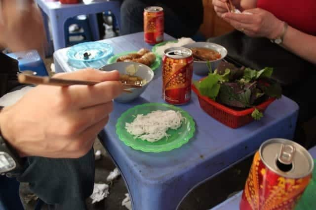 Eating street food in Hanoi