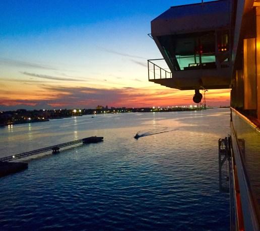 A ship balcony at sunset.