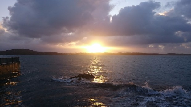 Morning sun over the waves on Iona, photo by Amanda Ogden