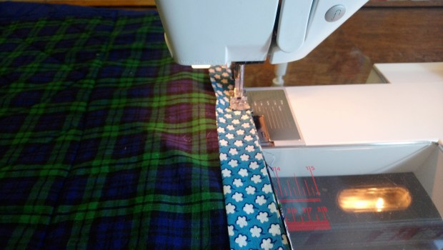 Sewing on a quilt binding