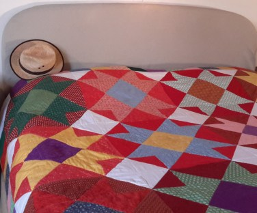 a patchwork quilt in vibrant colours, inspired by colours in Mexico