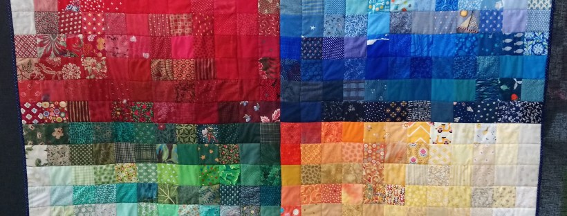 A quilt with four coloured quarters called Colour Mosaic by Amanda Jane Textiles