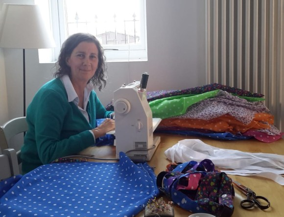 Amanda Jane Ogden sewing at the dining room table
