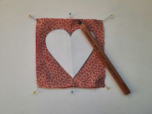reverse applique tutorial, drawing round the heart