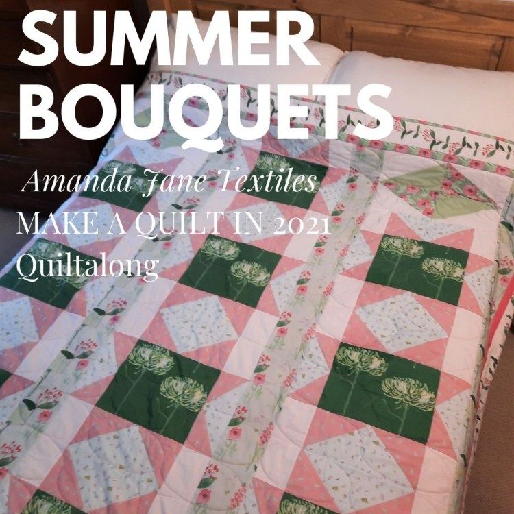 The 'Summer Bouquets' quilt on a bed