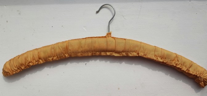 a coathanger covered in vintage fabric