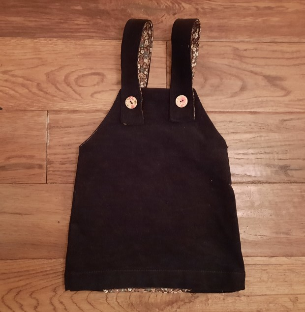 Toddler pinafore from a recycled skirt
