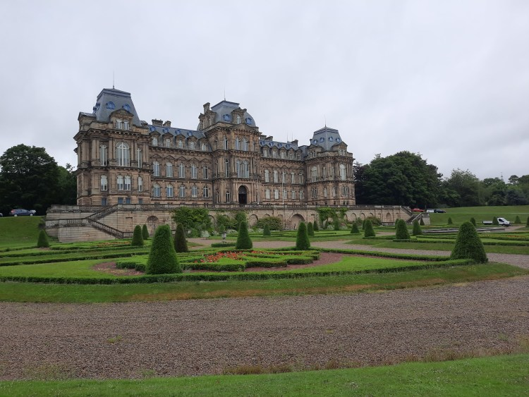 The Bowes Museum in Barnard Castle, seen from the bottom of the drive, showing the formal gardens in front