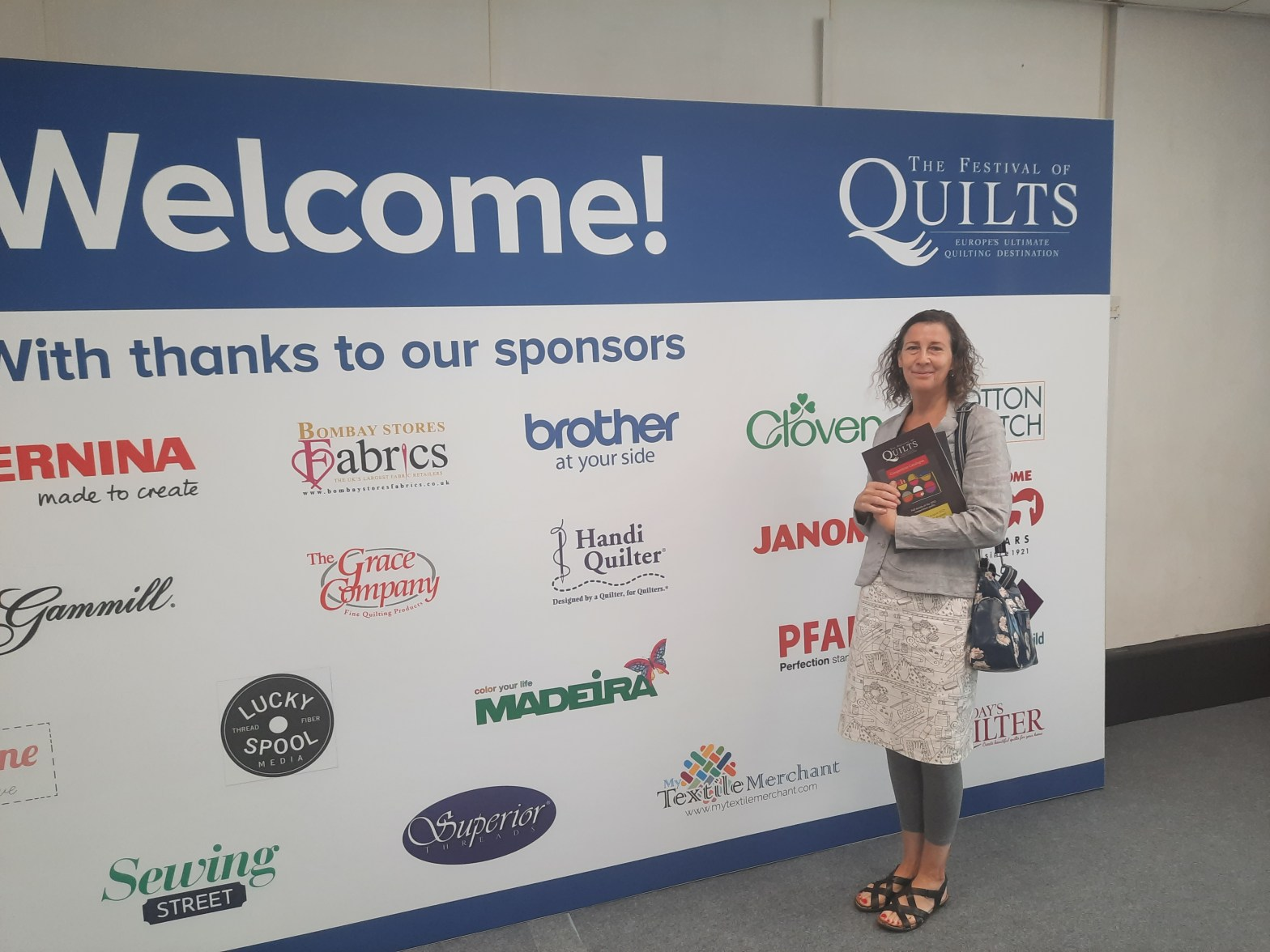 Amanda Jane Ogden at the entrance to the Festival of Quilts 2021