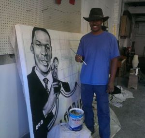Local muralist, Alexander Austin, working on a commission at Studio Joy.