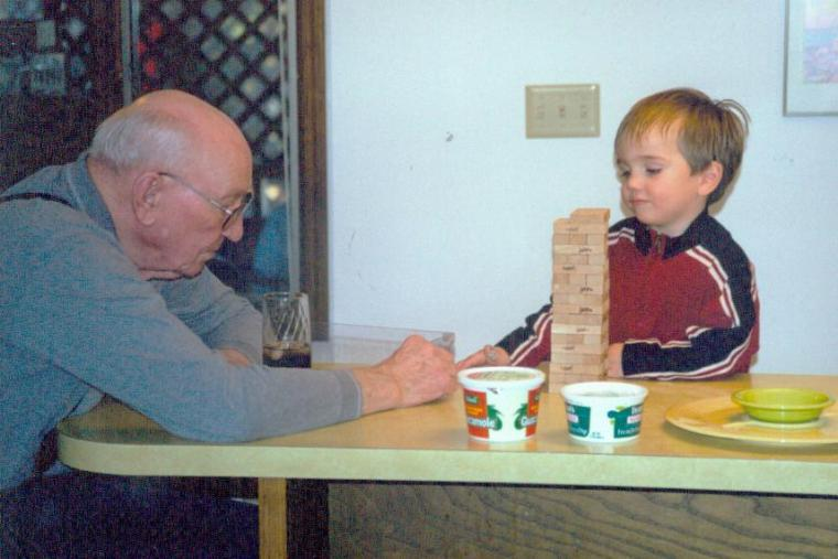 Grandpa and my son, 14 years ago. Both of these guys love games.