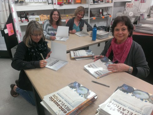Susan Stover, Crystal Neubauer, myself, and Michelle Belto signing the stack.