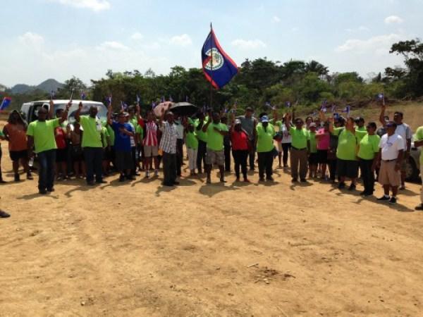 Teachers raise their Belizean flags at Jalacte 2