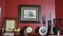 An old photograph of Hope House Farms hangs over the mantle. The house was built in 1880 and once belonged to Judge Charles A. Tweed, said Stephanie Garippa, house mother of Hope House. (LaCasse/AP)