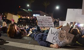 Protesters lie in the southern crosswalk of Roosevelt and Seventh streets Friday, December 5. Demonstrators rallied against alleged police brutality in the police involved deaths of Michael Brown and Eric Garner. (LaCasse/DD)