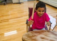 AMANDA SABGA/ STAFF PHOTO 8-year-old Youssef Gdihi partakes in Community Drum Circle lead by SoulWorks Rhythm at the Center at Punchard in Andover on June 25, 2015.