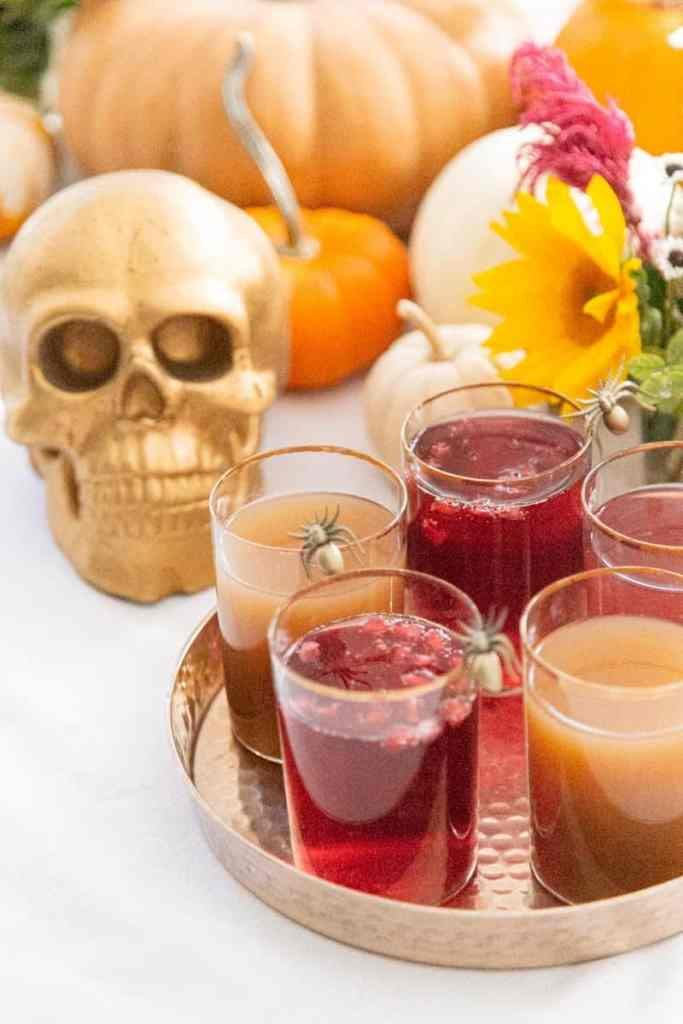apple cider pomegranate sparklers with spooky decorations