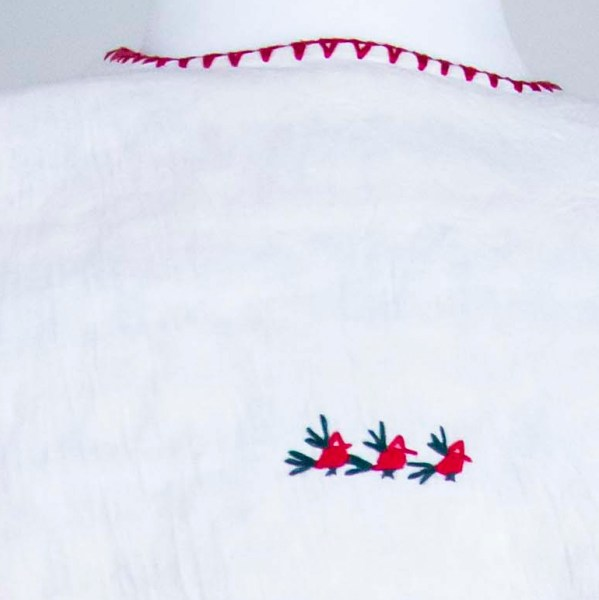 Traditional handmade Mexican embroidered white blouse made of cotton detail back view