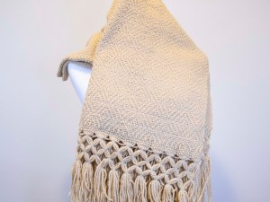 Front view of a Traditional Handwoven Mexican Beige Shawl Scarf Wrap made of 100 % cotton on a mannequin