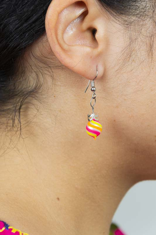 Girl wearing swirl-hand-blown-glass-pink-yellow-orange-earrings-128