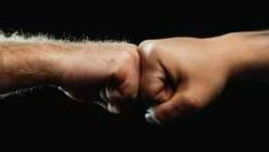 close up of two people fist bumping each other