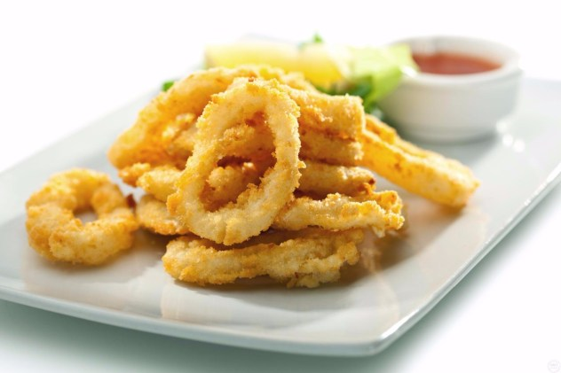 Amarcord's hand cut squids rings lightly battered served with home made tartar dip