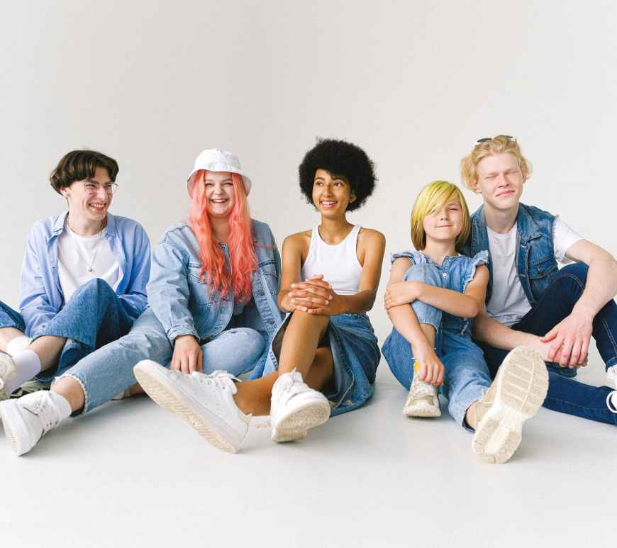 delighted multiethnic group of models in modern denim clothes