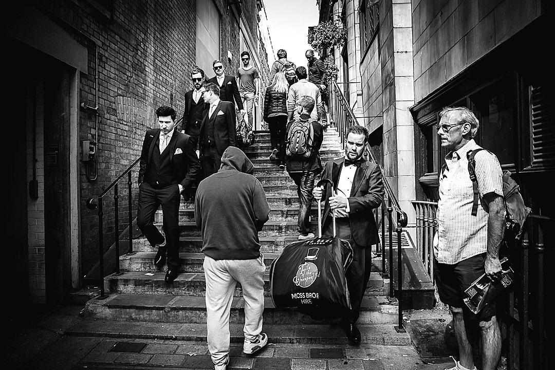 Corinthia Hotel Wedding Photographer Groom making way to The Trafalgar Hotel