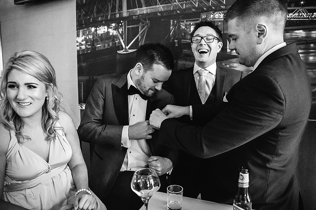 Corinthia Hotel Wedding Photographer groom having drinks at Trafalgar Hotel