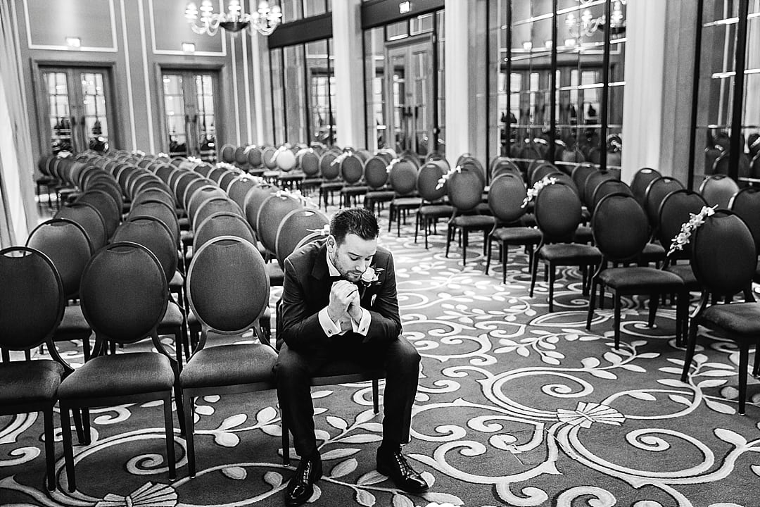 Corinthia Hotel Wedding Photographer Groom in quiet reflection before the ceremony