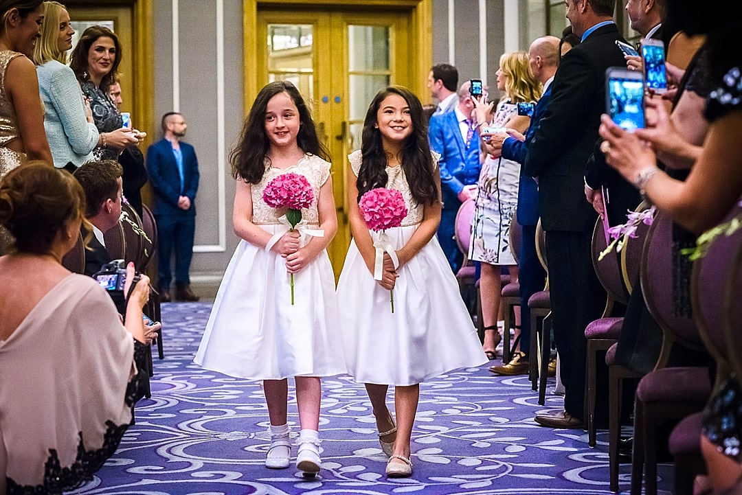 Corinthia Hotel Wedding Photographer flower girls walking up the aisle