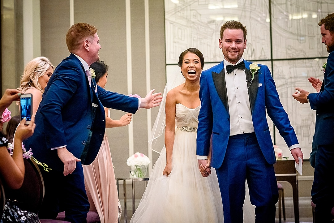 Corinthia Hotel Wedding Photographer Bride and Groom ecstatic after getting married