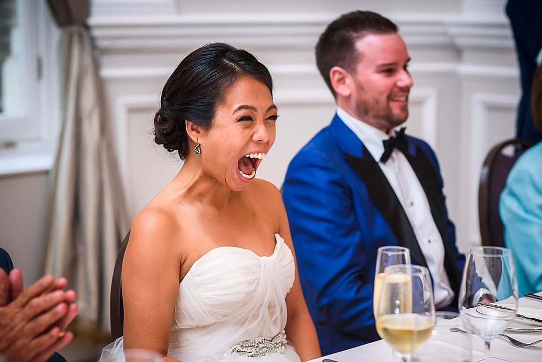 Corinthia Hotel Wedding Photographer Delighted bride during the speech