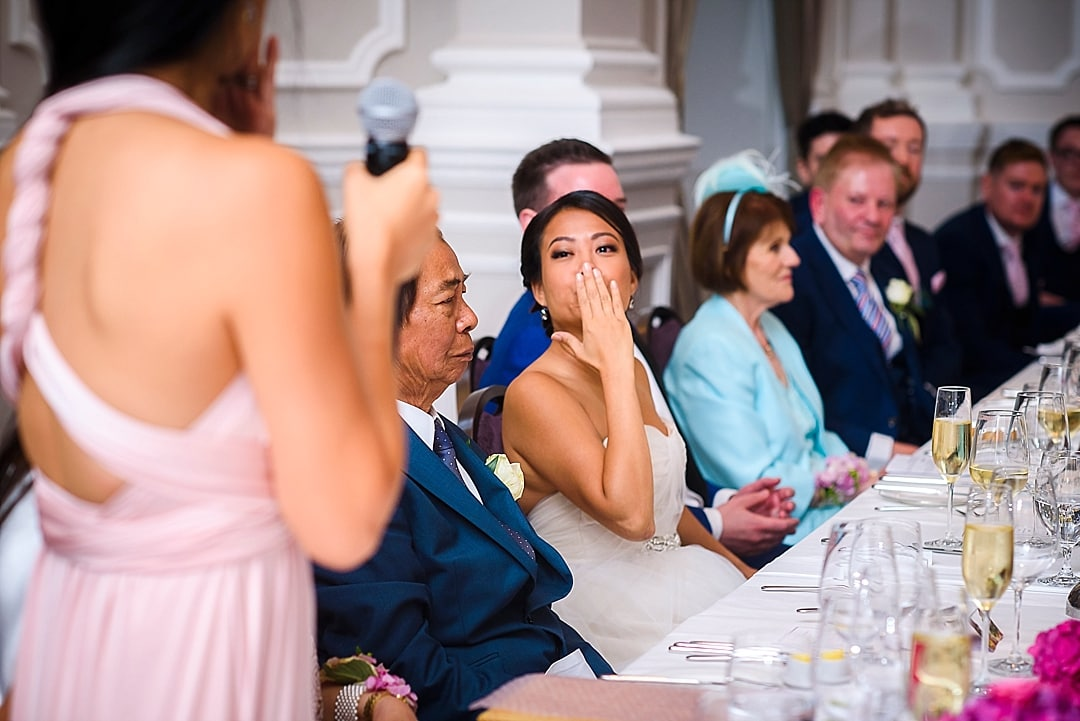 Corinthia Hotel Wedding Photographer bride sending a flying kiss to her sister