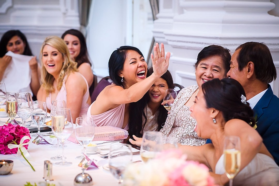 Corinthia Hotel Wedding Photographer bride and sister high five during the speech