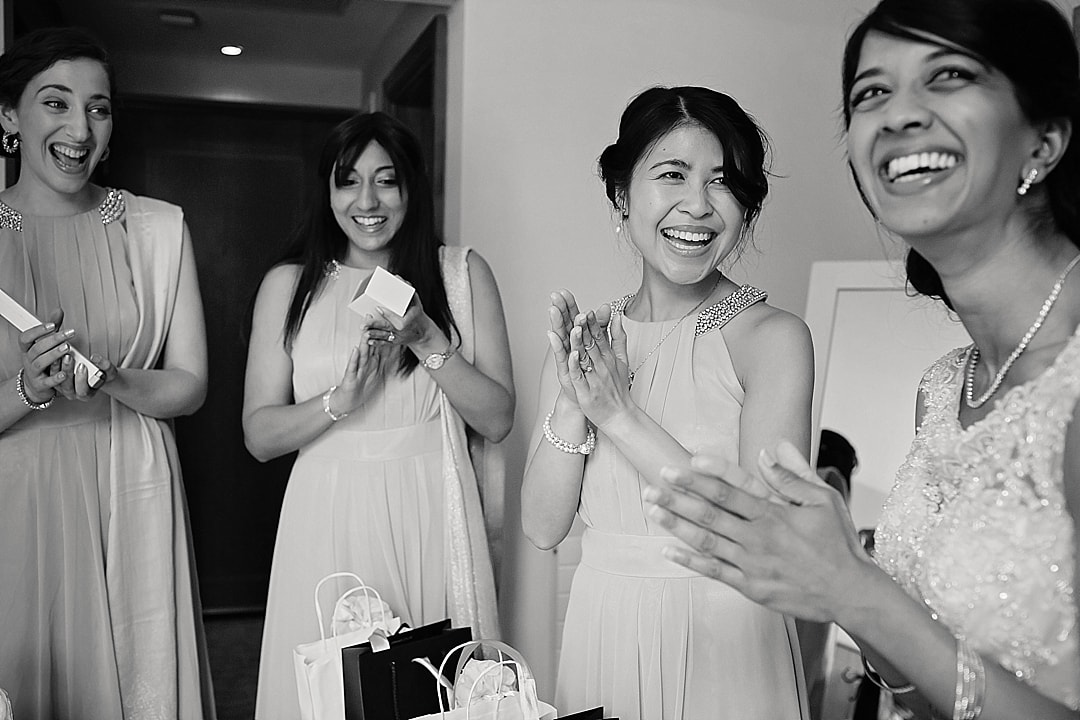 vill Court Wedding Photography Bridesmaids receiving presents