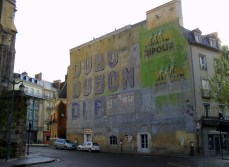 Old 1920s advertising on a building in Rennes, France