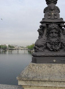 Lamp base on the Pont Neuf I took in Paris in spring. The first true view of the city I had in my life after debouching from the Metro.