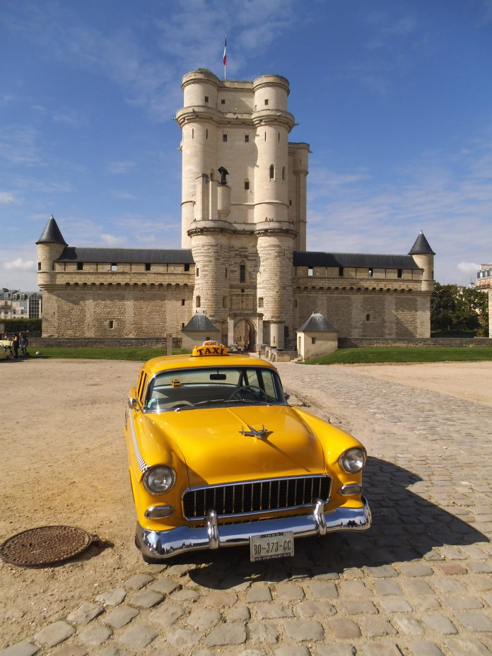 Such a peculiar contrast. A vintage car show in the grounds of a 14th century castle. I snapped this just as the show was ending. Vincennes