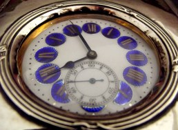 This blue and white enameled silver watch sits in a my bookcase.