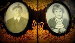 Family peeks through this 1920's frame.