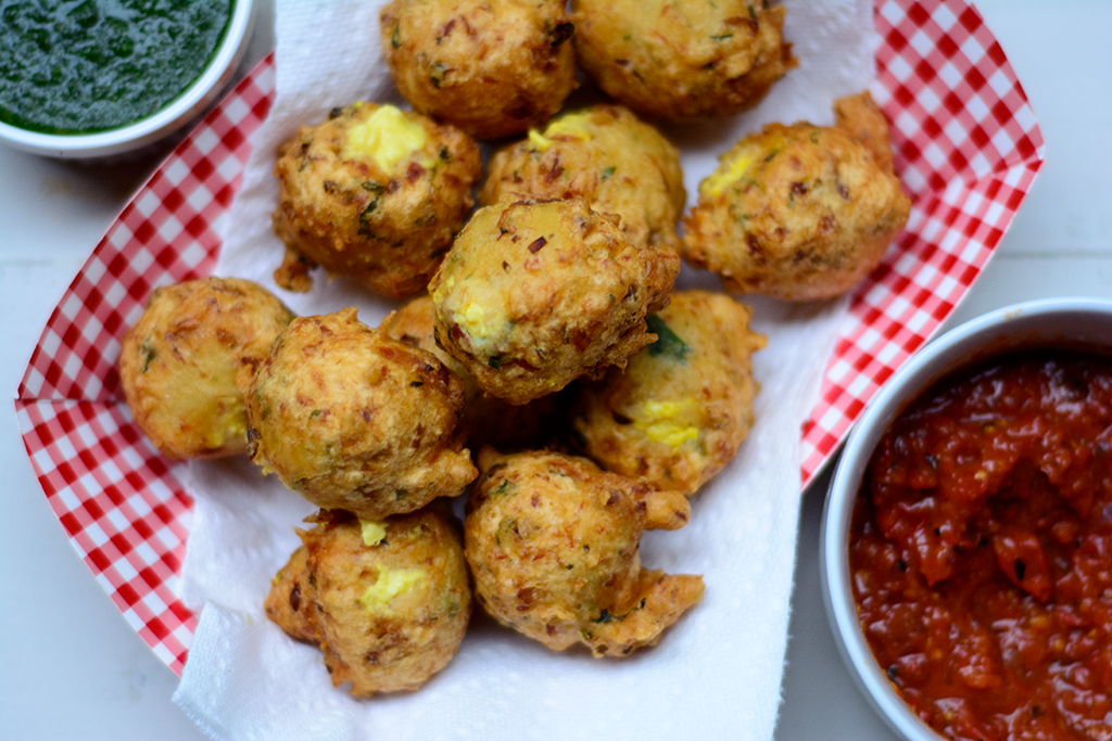 Ackee-stuffed-saltfish-fritters-with-charred-tomato-sauce-and-cilantro-sauce