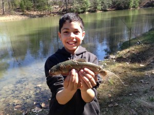 Christian proudly showing off his brook trout