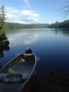 A gorgeous view of Farrington Pond with White Mountain National Forest as a backdrop