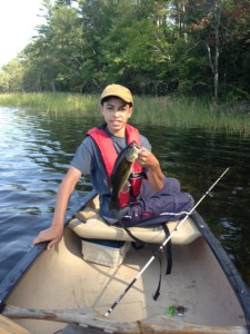 Christian caught this little bass right where the eastern shoreline merges into the large marsh. I caught a small pike in the same area.