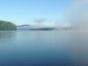 The fog over Panther Pond is being burned off by the rising sun