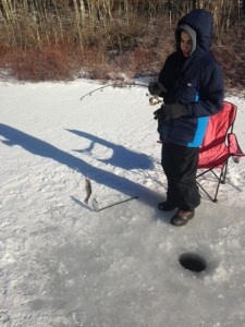 Christian jigs up a small brook trout