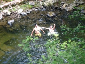 Joel and Salvy take a refreshing dip in Pierce Pond Stream to cool down/
