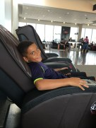 Carlos enjoying the massage chair at the airport.