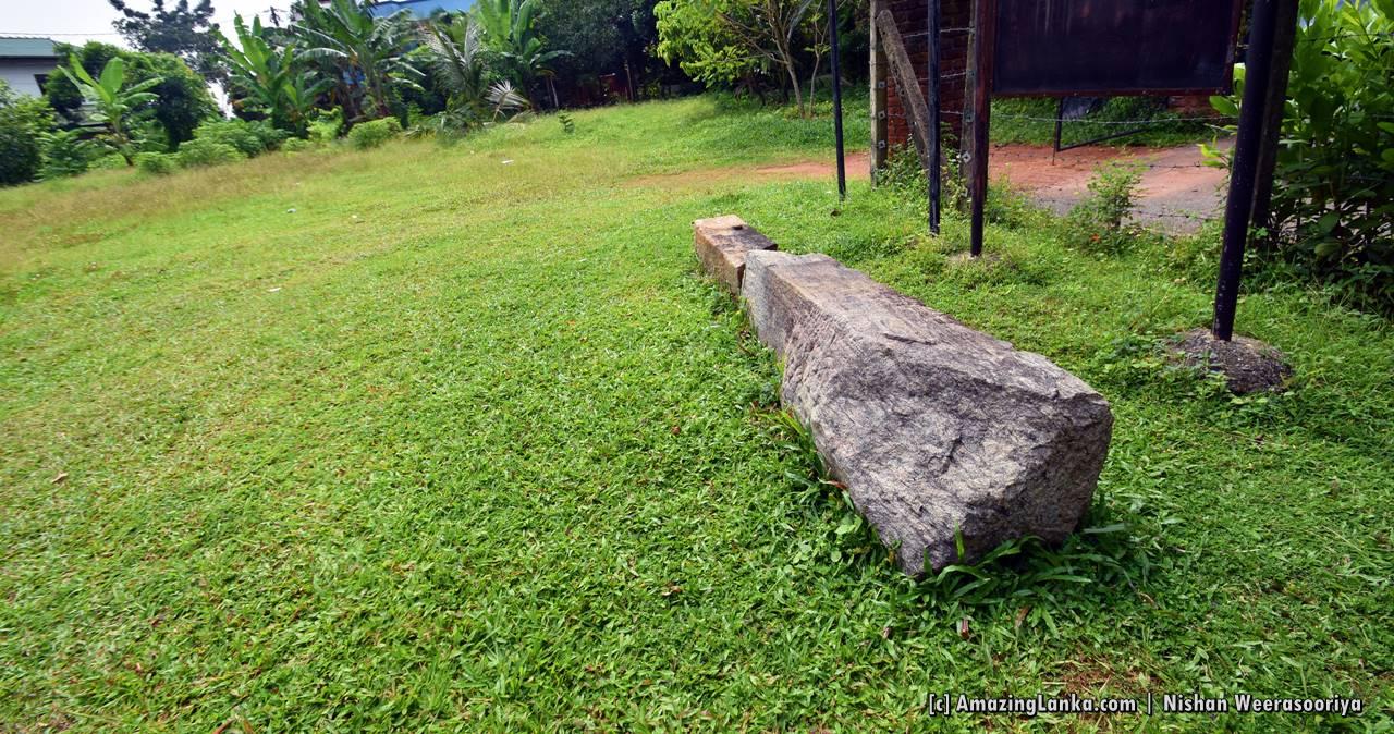 Tomb of Alakeshwara - Some granite artifacts lying around.
